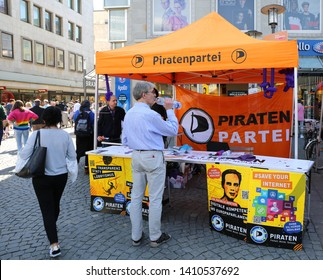 BIELEFELD,GERMANY-APRIL 20:Unidentified Man getting information from  Pirate Party Tenth.April 20,2019 in Bielefeld,Germany.