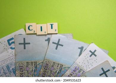 Bielsko, Poland - 09.29.2021: CIT inscription next to Polish money. CIT is a Corporate Income Tax. Concept showing the payment of taxes by enterprises.