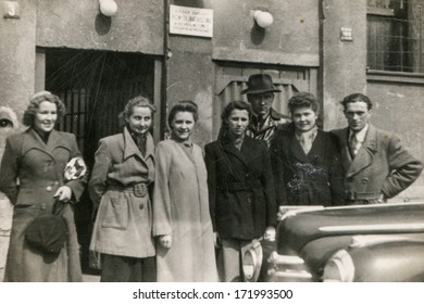 BIELSKO, POLAND, CIRCA 1940s: Vintage photo of group of workers of linen industry manufacture in front of their workplace