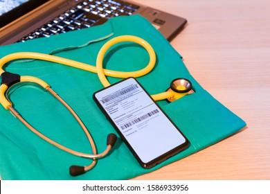 Bielsko-Biala, Poland - December 12 2019: Mobile electronic prescription (e-recepta) on a smartphone on the doctor's desk. Tele, online medicine concept.