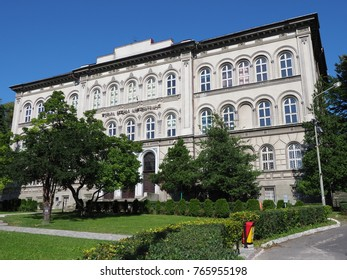 BIELSKO-BIALA, POLAND / EUROPE on SEPTEMBER 2017: Historical building of High School of Administration in city center seen from green park with clear blue sky in warm sunny summer day.