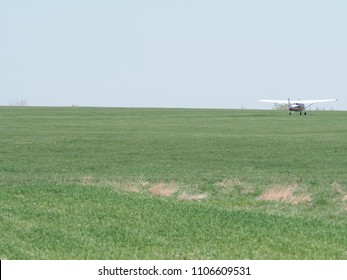 BIELSKO-BIALA, POLAND on APRIL 2018: Reims-Cessna F172H Skyhawk SP-AKT airplane on grassy airfield taxiing to takeoff, belongs to air club in european city, clear blue sky in warm sunny spring day