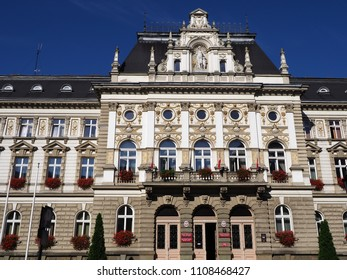 BIELSKO-BIALA, POLAND on AUGUST 2017: Historical elevation of town hall building in european city center seen from parking with clear blue sky in warm sunny summer morning day.