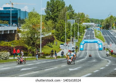 Bielsko-Biala, silesian voivodesphip, Poland - 05.19.2019: Disabled bikers ride recumbent bicycle main street during Fiat Run in 10 km Bielsko-Biala
