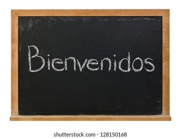 Bienvenidos or welcome written in white chalk on a black chalkboard isolated on white