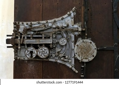 Biertan Transylvania, Romania - August 16 2018: The richly decorated intarsia door of the sacristy of the the fortified church has a complex lock, displayed at the 1889 Paris World's Fair