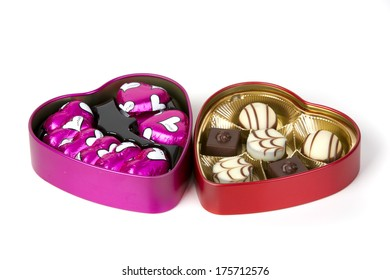BIETIGHEIM, GERMANY - FEBRUARY 06, 2014: Photo of two heart shaped box of the famous chocolate pralines for valentine's day by the Swiss Lindt company on white background.