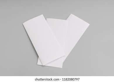 Bifold white template paper on blue background.