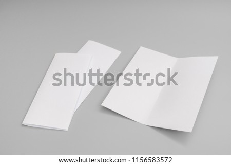 bifold white template paper on blue stock photo edit now