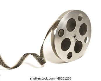 Big 16 mm monochrome motion picture film reel, isolated over white background