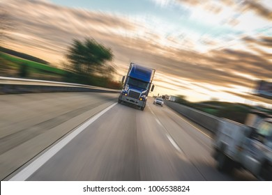 Big 18 wheeler semi truck on highway with motion blur
