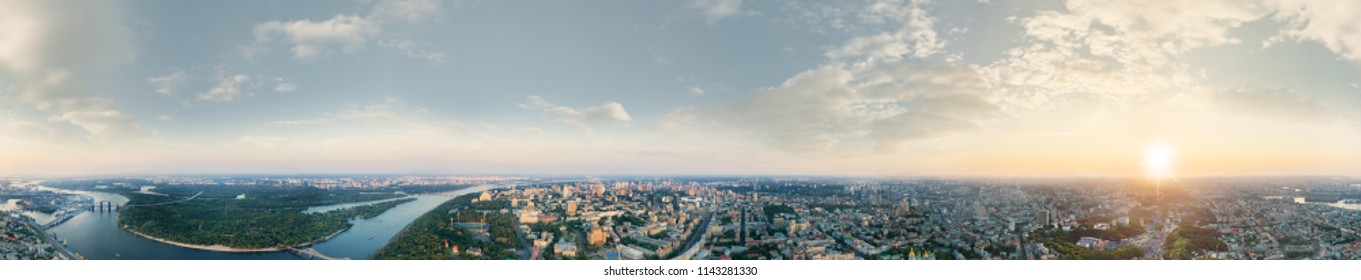 A big 360 degrees panorama of the city of Kiev at sunset. A modern metropolis in the center of Europe against the backdrop of sunset sky from a bird's eye view. Aerial view. Panorama of the Tourist