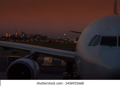 Big Airliner at gate with New York City in the background