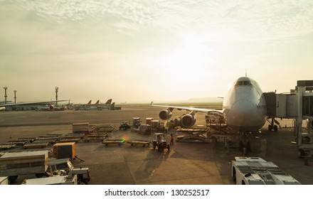big airplane at airport in beautiful morning light through glass