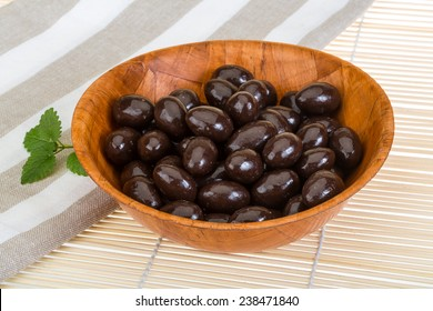 Big Almond in chocolate on the bowl