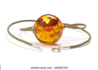Big amber charm isolated on the white background