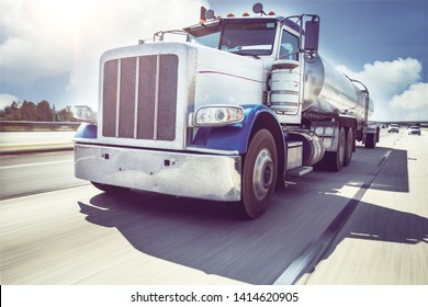 big american style truck with tanker on the freeway