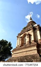 Big ancient pagoda on blue sky background at Wat Ched yod or Wat Photharam Maha Wihan on day time at Chiang Mai, Thailand.