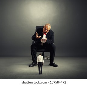 big angry boss screaming at small bad worker