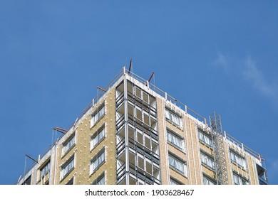 Big apartment buildings under construction. Building under construction against blue sky