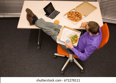 Big appetite in office - man heaving break for pizzas