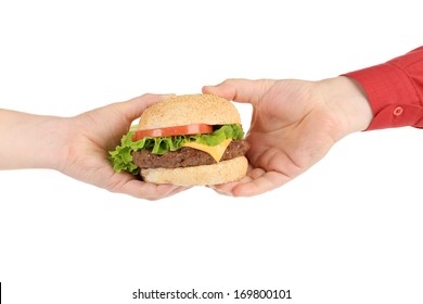 Big appetizing hamburger in hand. Isolated on a white background.
