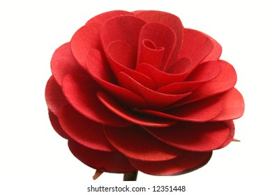 Big artificial red rose isolated on white background