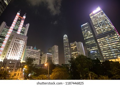a big asia city by night to the sunrise with all the lights on the streets and skyline