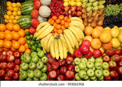 Big assortment of fresh organic fruits. Frame composition of fruits on market stall