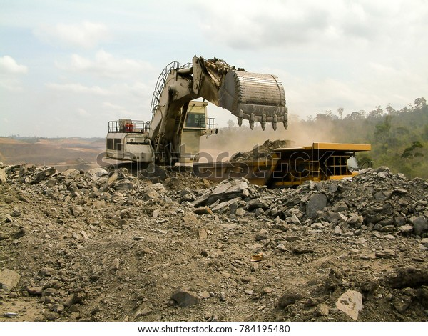 Big Backhoe Loads Gravel Dump Truck Stock Photo (Edit Now