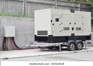 Big Backup Generator for Office Building connected to the Control Panel with Cable Wire