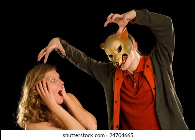 the big bad wolf and scared woman on the black background