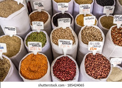 Big bags of fresh and colorful grains for sale in a Brazilian market.
