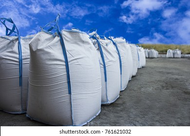 big bags on the outdoor warehouse on the background of blue sky with clouds.