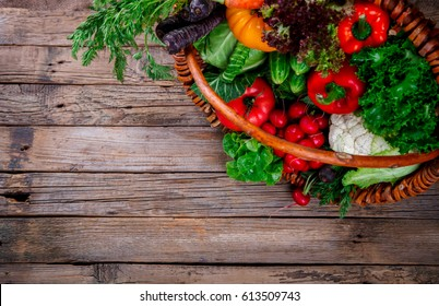 Big Basket with different Fresh Farm Vegetables. Harvest. Food or Healthy diet concept.Vegetarian.selective focus.