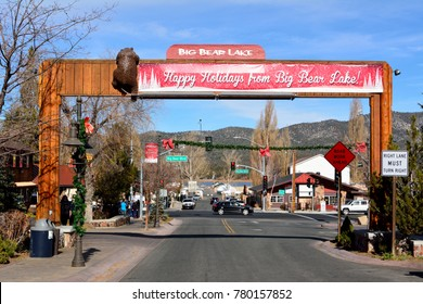Big Bear Lake, California, United States of America - December 2, 2017. View of main street, Pine Knot Avenue, in Big Bear Lake, with season decorations, buildings and cars.