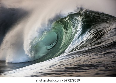 Big beautful perfect surfing waves barreling in the Atlantic Ocean.