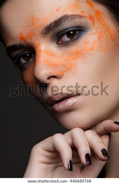 big beauty portrait on gray background. beautiful girl's face. hand near the face. orange eye drops. art beauty
