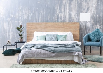 Big bed in stylish interior of room