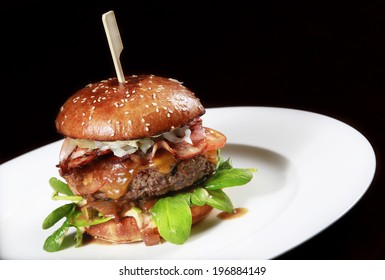 big beef burger with cheese bacon and fresh vegetable