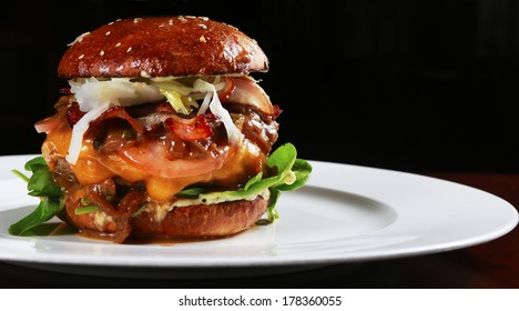 big beef burger full of fresh vegetable