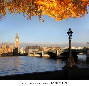 Big Ben with autumn leaves in London, England