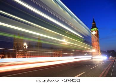 Big Ben behind light beams at twilight time