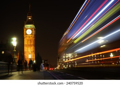Big Ben, bus lights trail present, seen from Westminster Bridge at Night