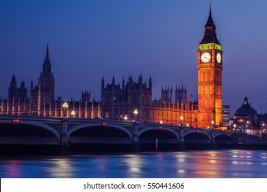 Big Ben clock tower on River Thames in Westminster, London at night