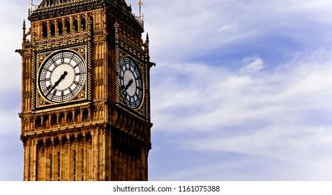 Big Ben Clock Tower Palace of Westminster London United Kingdom with blue sky and white cloud in June 2009