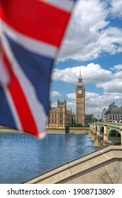 Big Ben with flag of England in London, England, UK