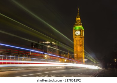 Big Ben and House of Parliament at dramatic night with light trails on Westminster bridge, London, United Kingdom
