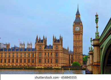 Big Ben and the House of Parliament of UK viewed from the opposite side of River Thames, along with Westminster Bridge