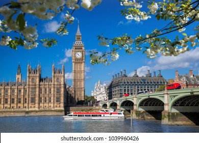 Big Ben and Houses of Parliament with boat during spring time in London, England, UK